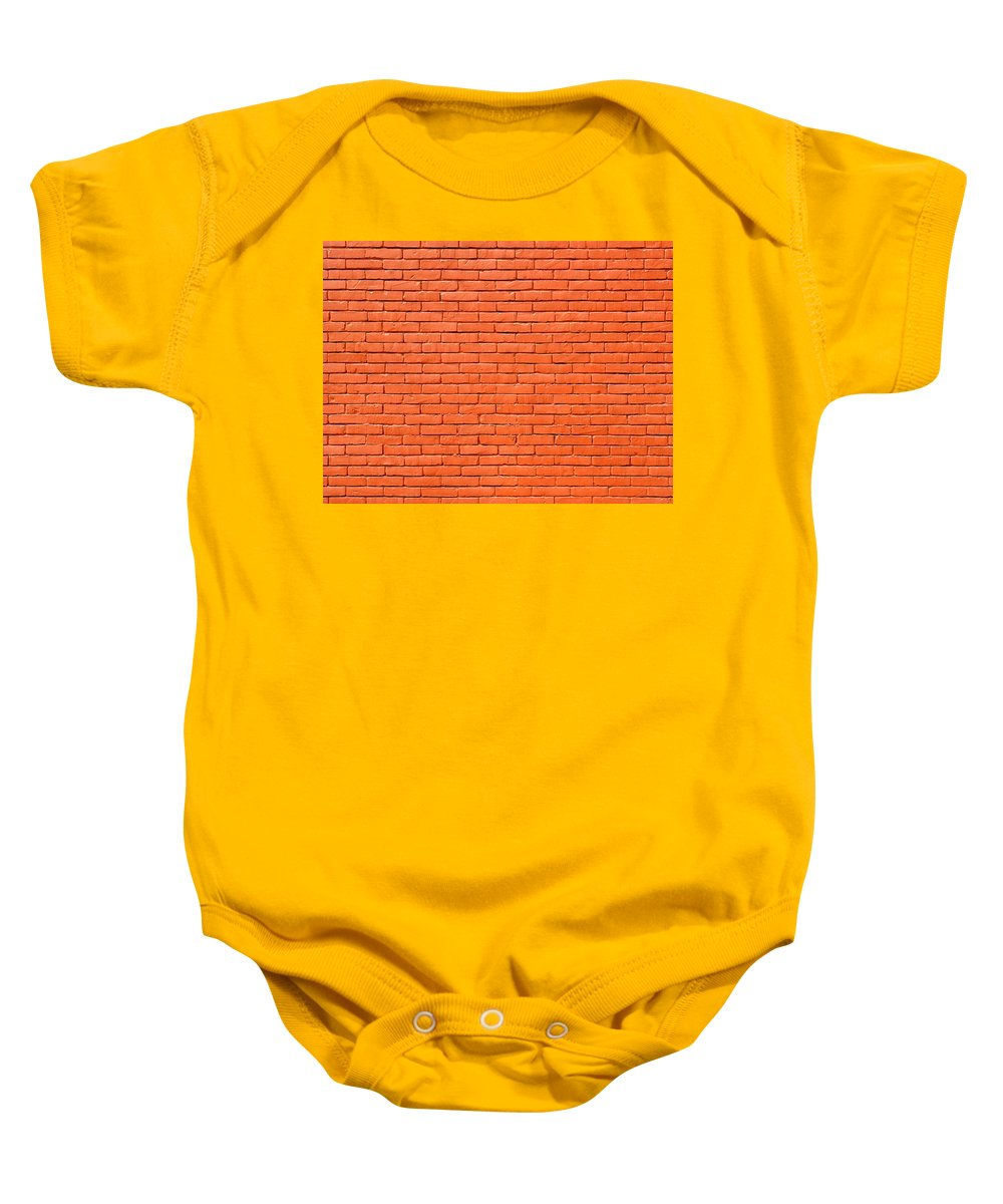 Brick Baby Onesie featuring the photograph Painted Brick Wall by Dutourdumonde Photography