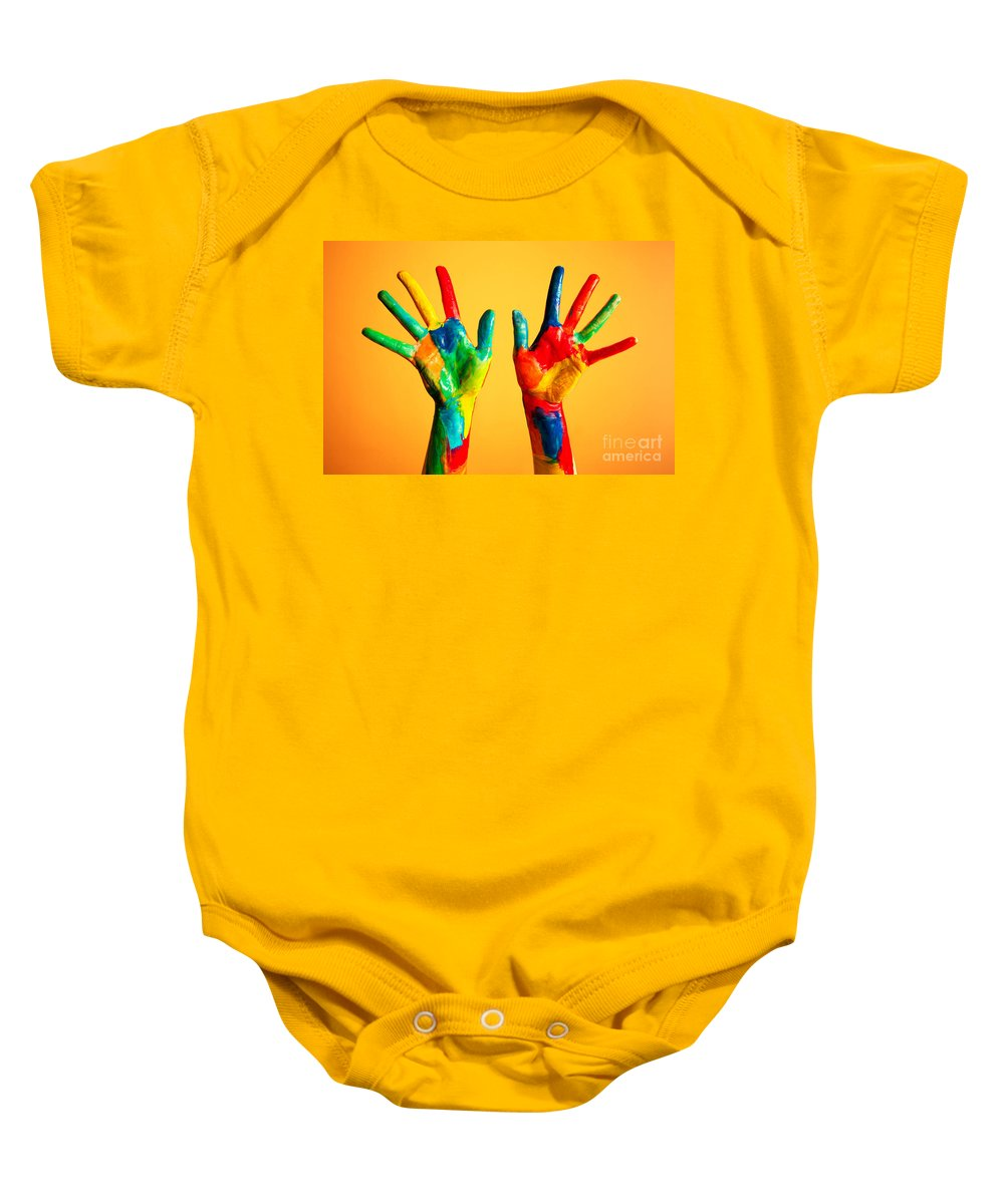 Hand Baby Onesie featuring the photograph Painted Hands by Michal Bednarek