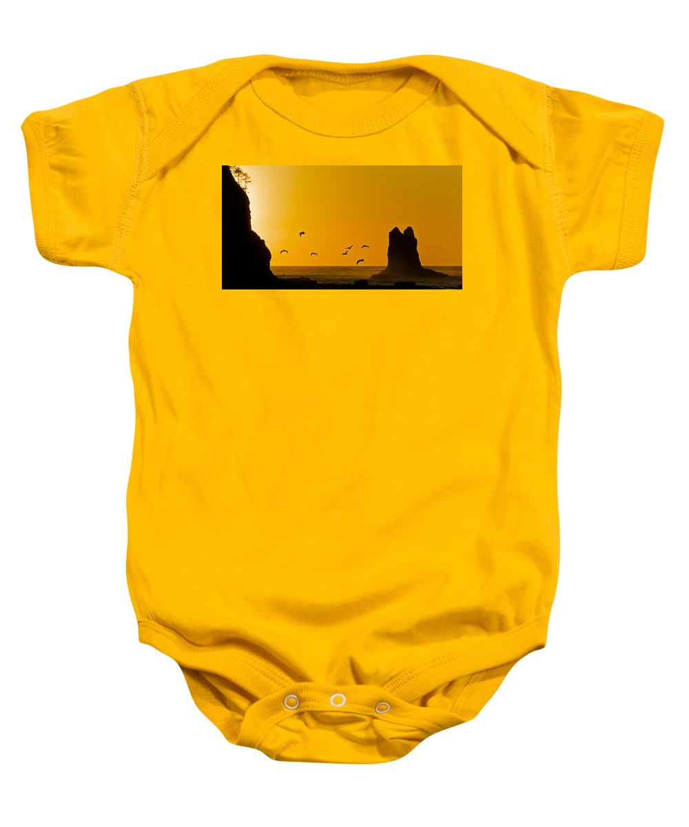 La Push Baby Onesie featuring the photograph Pelicans On The Wing II by Greg Reed