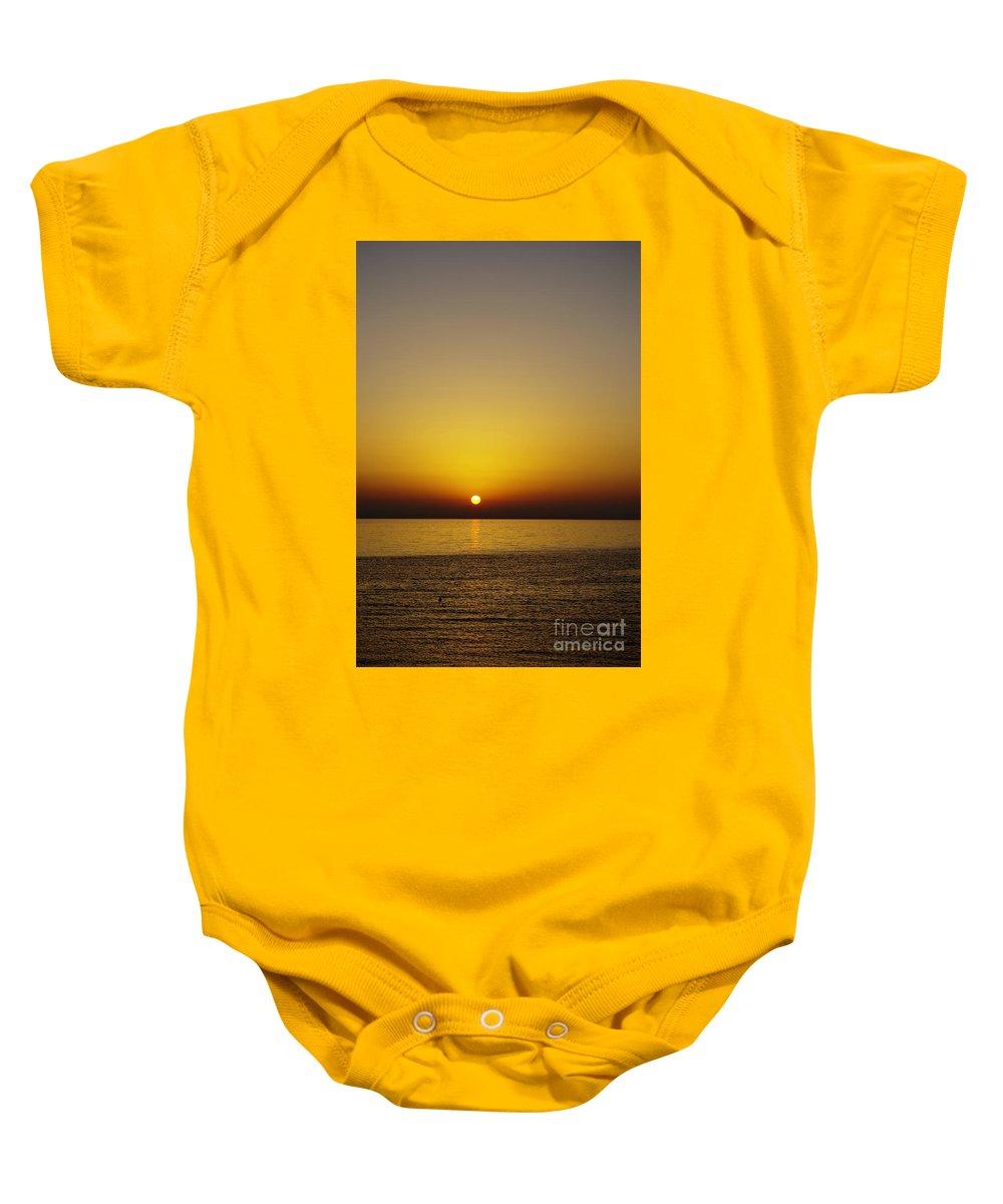 Sun Baby Onesie featuring the photograph Sunset Swim by Zoran Berdjan