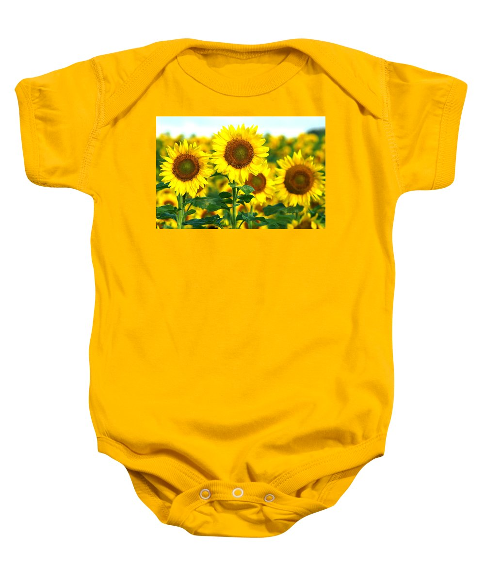 Sunflower Baby Onesie featuring the photograph Sunshine On A Stalk by Bill Pevlor