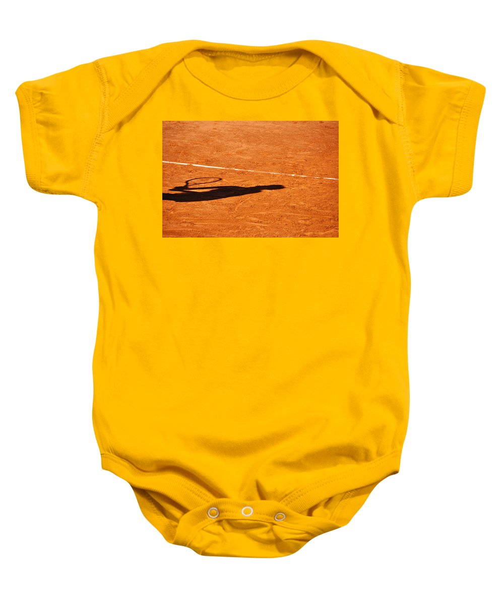 Clay Baby Onesie featuring the photograph Tennis Player Shadow On A Clay Tennis Court by Dutourdumonde Photography