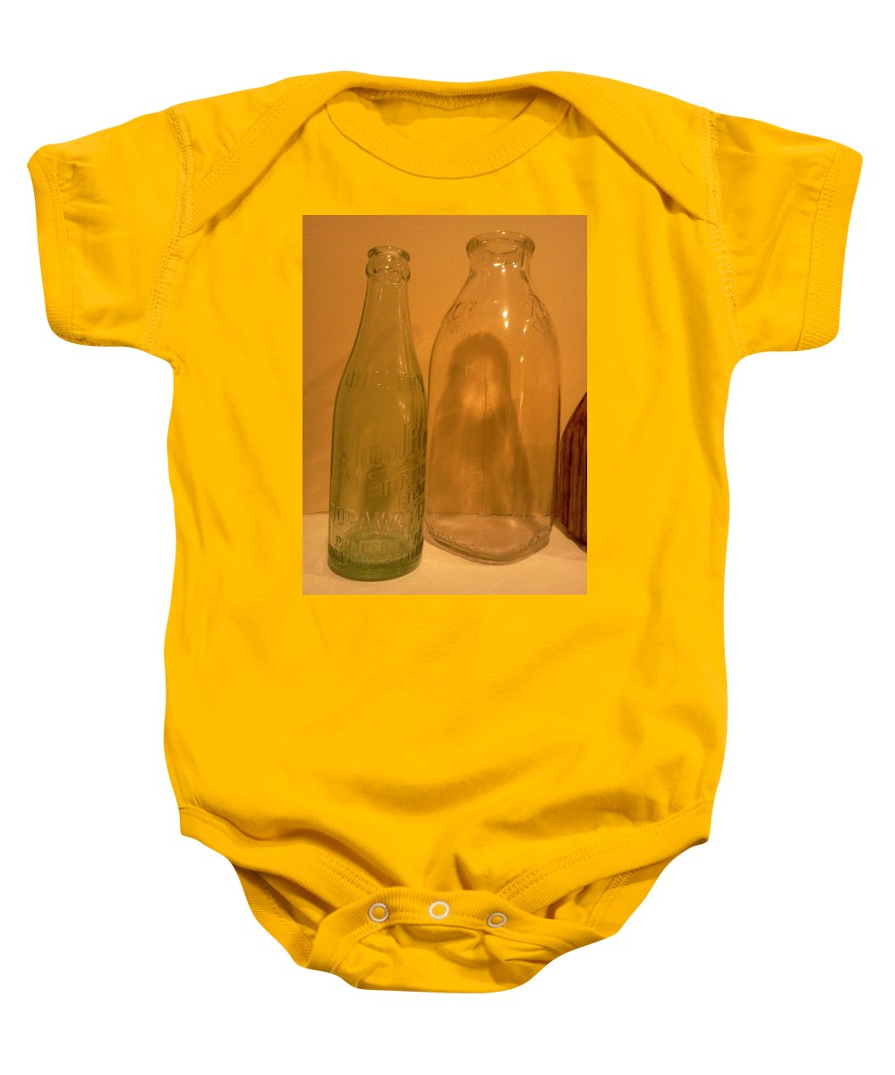 Bottles Baby Onesie featuring the photograph Face In The Bottle by Stacy C Bottoms