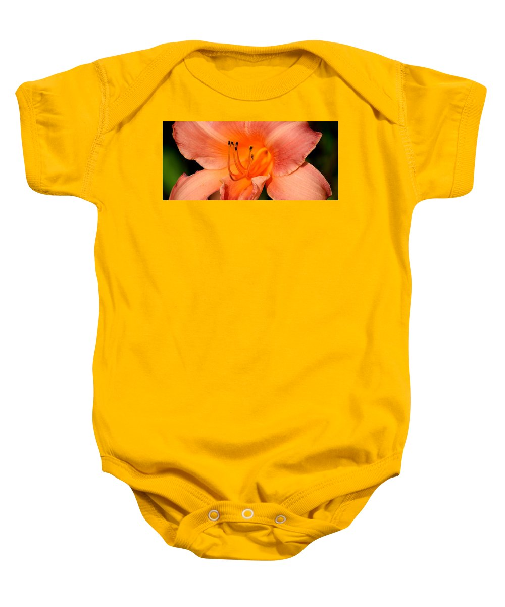 Glowing Baby Onesie featuring the photograph Glowing Orange by Maria Urso