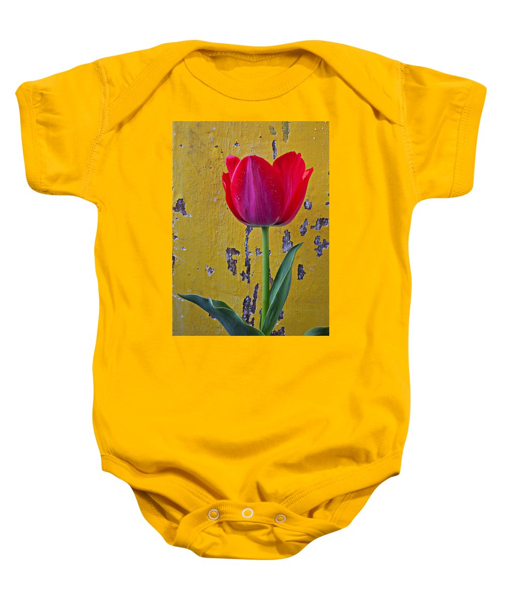 Red Baby Onesie featuring the photograph Red Tulip With Yellow Wall by Garry Gay
