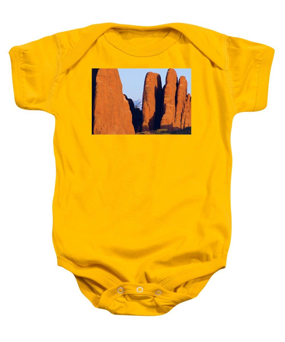 Utah Baby Onesie featuring the photograph Sandstone Fins by Steve Stuller