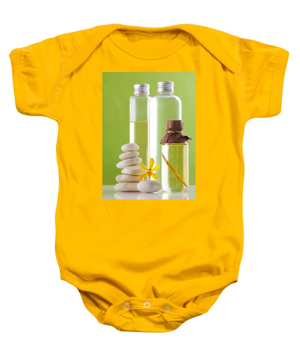Spa-treatment Baby Onesie featuring the photograph Spa Oil Bottles by Atiketta Sangasaeng