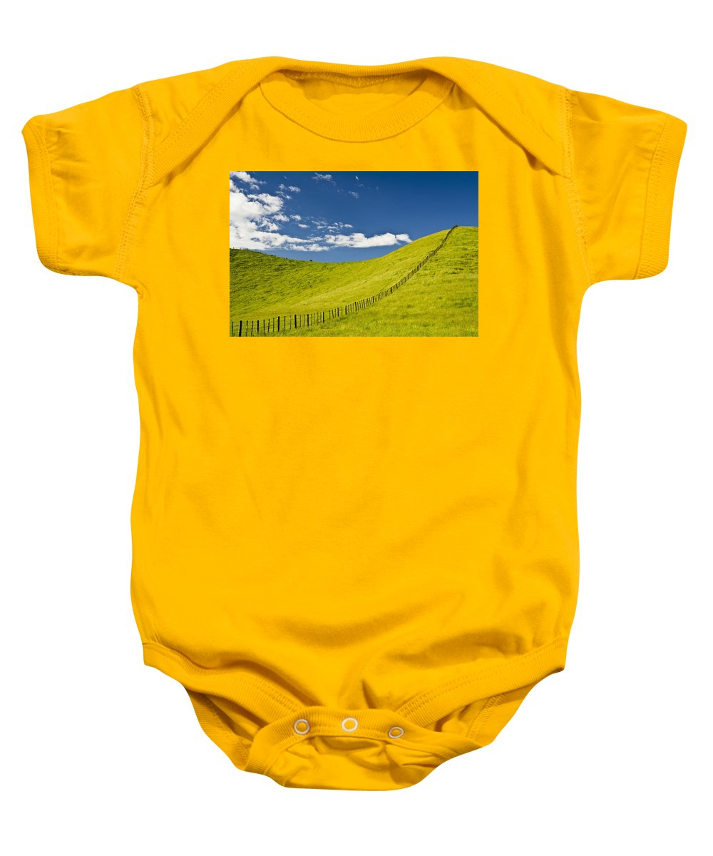 Clouds Baby Onesie featuring the photograph Wooden Fence Posts Running Through A by David DuChemin