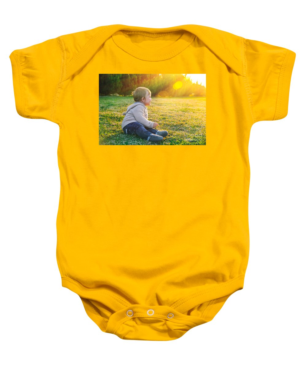 Adorable Baby Onesie featuring the photograph Adorable Baby Playing Outdoors by Anna Om