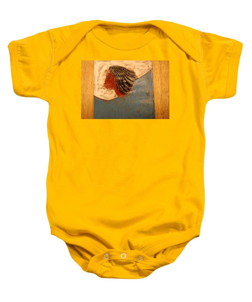 Jesus Baby Onesie featuring the ceramic art Angel - Tile by Gloria Ssali