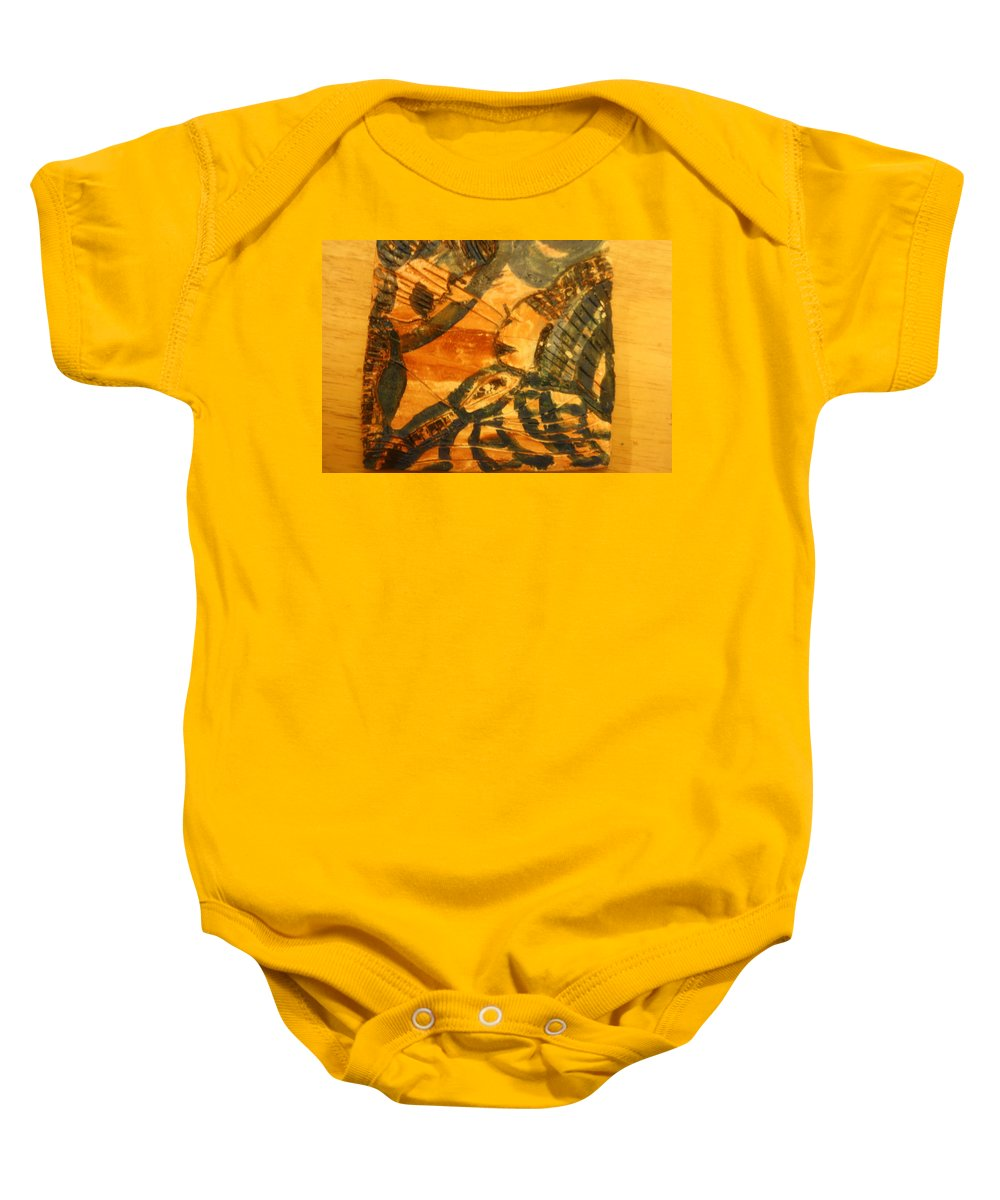 Jesus Baby Onesie featuring the ceramic art Care - Tile by Gloria Ssali