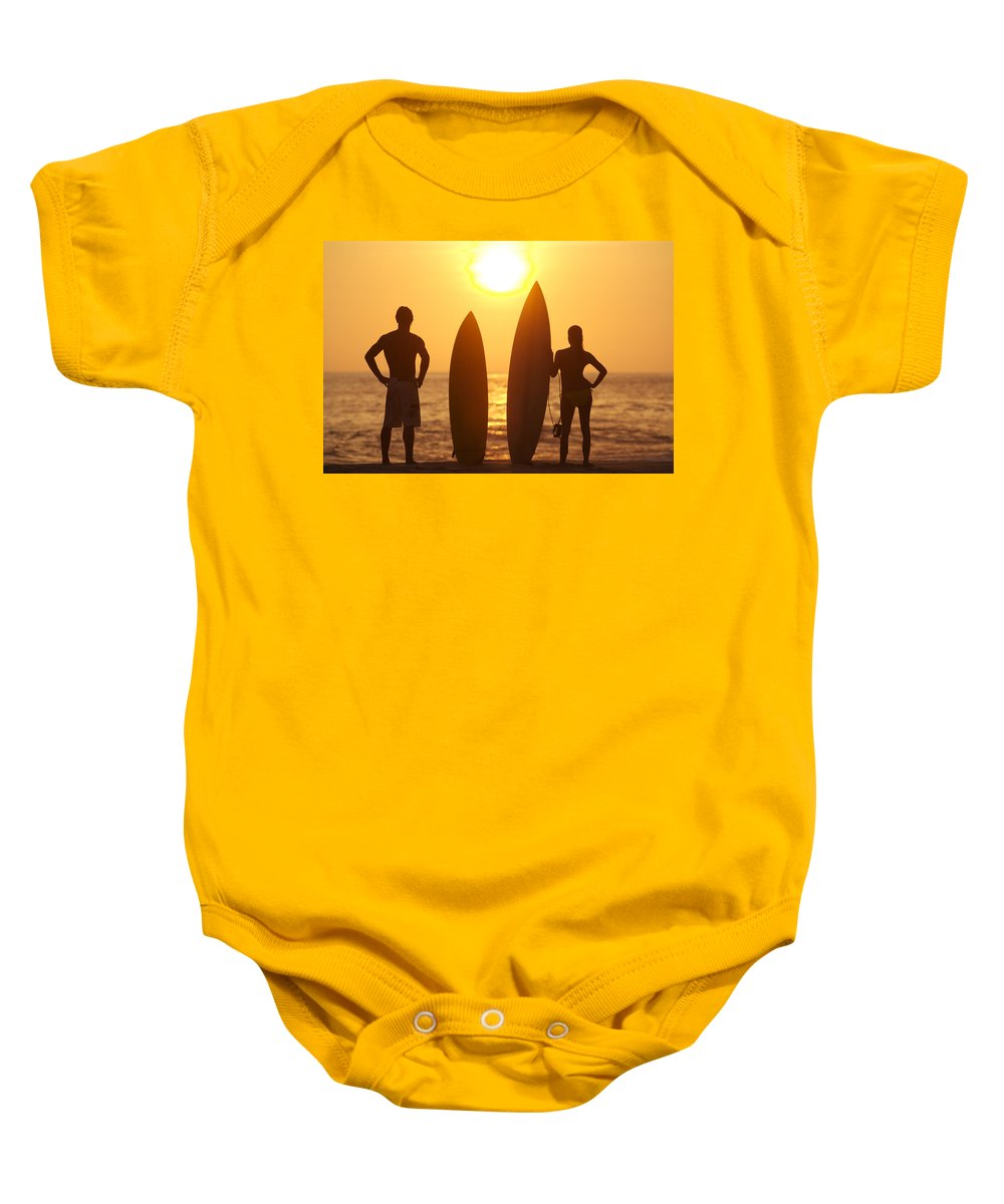Afternoon Baby Onesie featuring the photograph Surfer Silhouettes by Larry Dale Gordon - Printscapes
