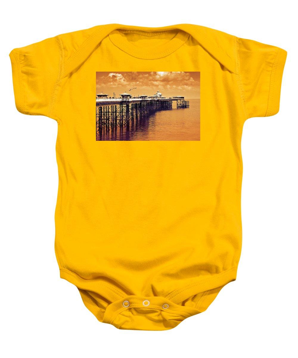 Llandudno Baby Onesie featuring the photograph Llandudno Pier North Wales Uk by Mal Bray