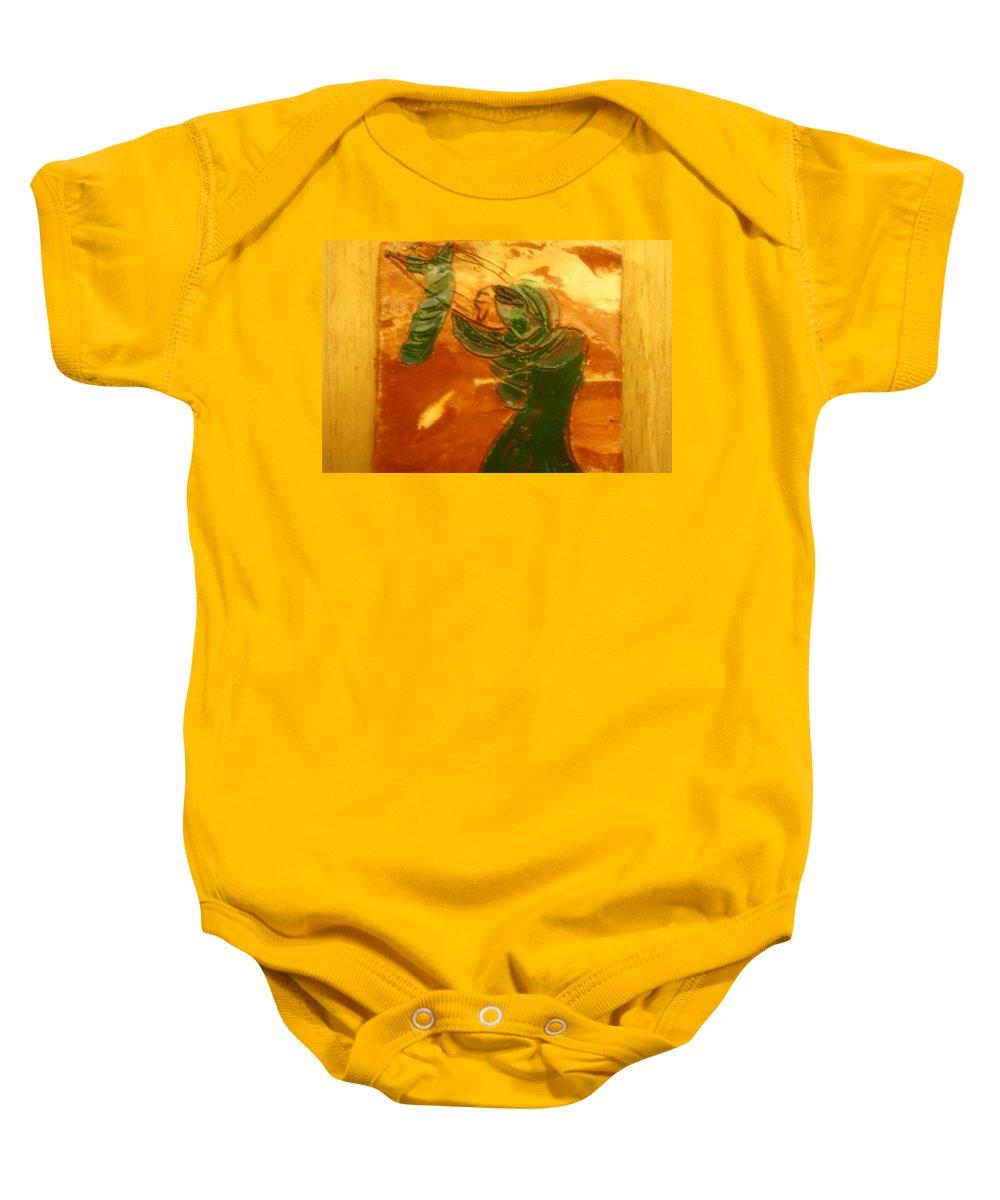Jesus Baby Onesie featuring the ceramic art Mums Love - Tile by Gloria Ssali