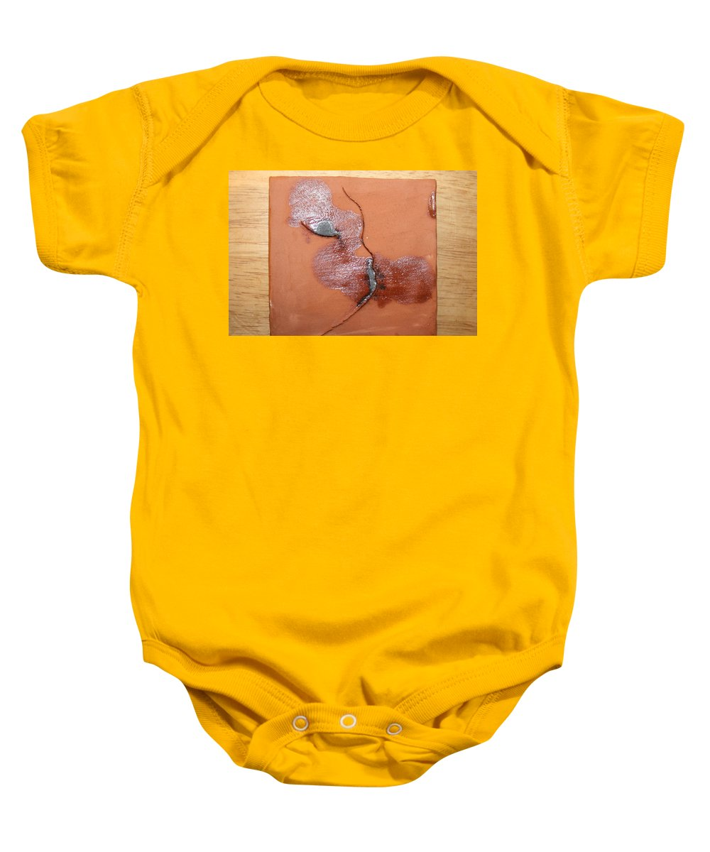 Jesus Baby Onesie featuring the ceramic art Loss - Tile by Gloria Ssali