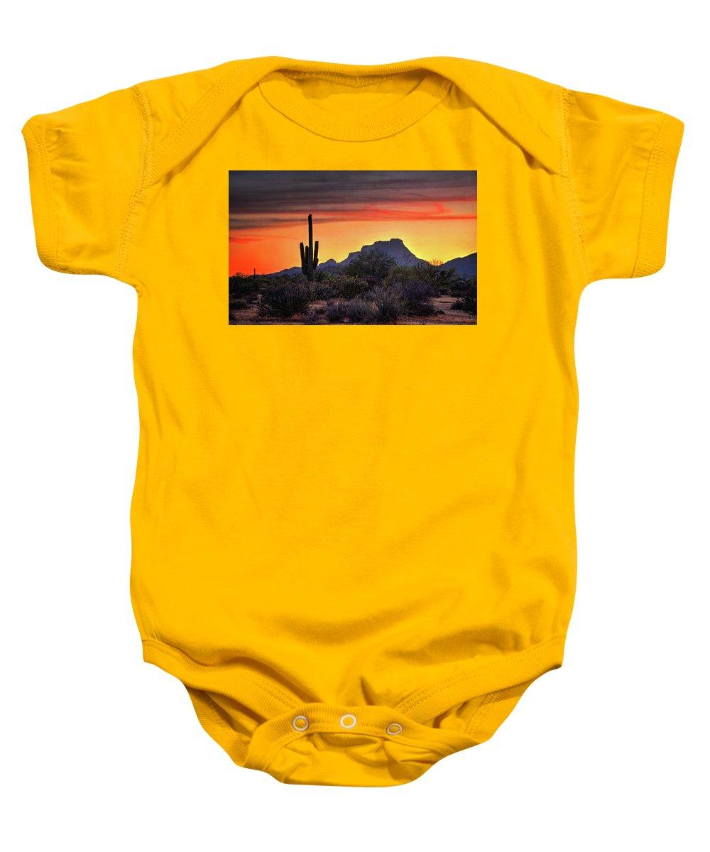 Saguaro Sunset Baby Onesie featuring the photograph As The Sun Sets On Red Mountain by Saija Lehtonen