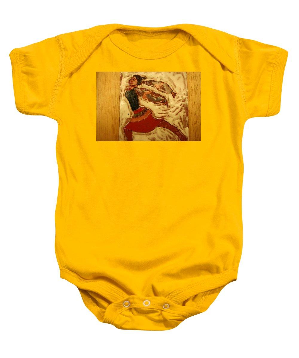 Jesus Baby Onesie featuring the ceramic art Double Dutch - Tile by Gloria Ssali