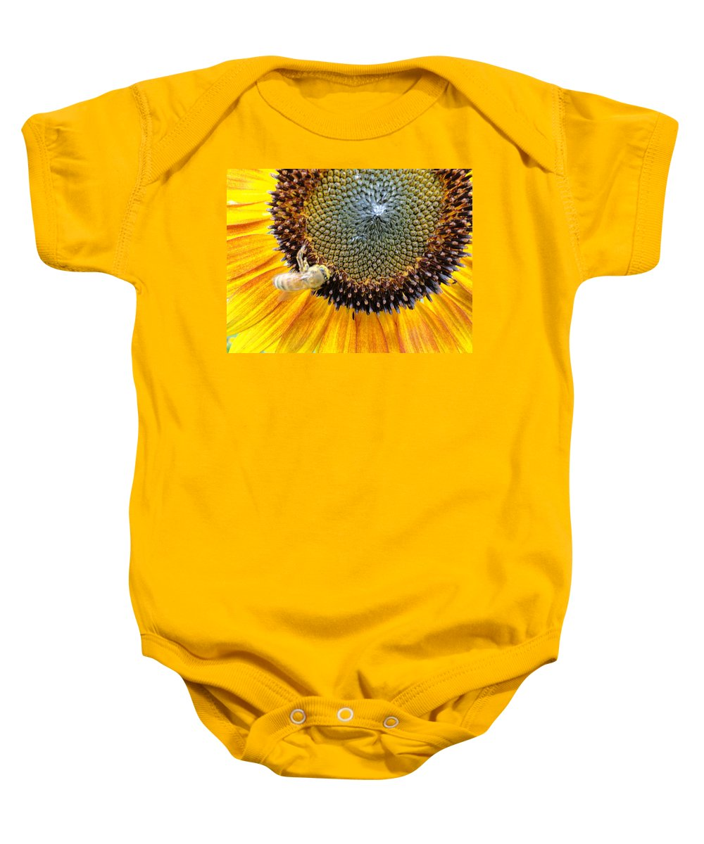 Sunfllower Baby Onesie featuring the photograph Drunken Bee by Trish Hale