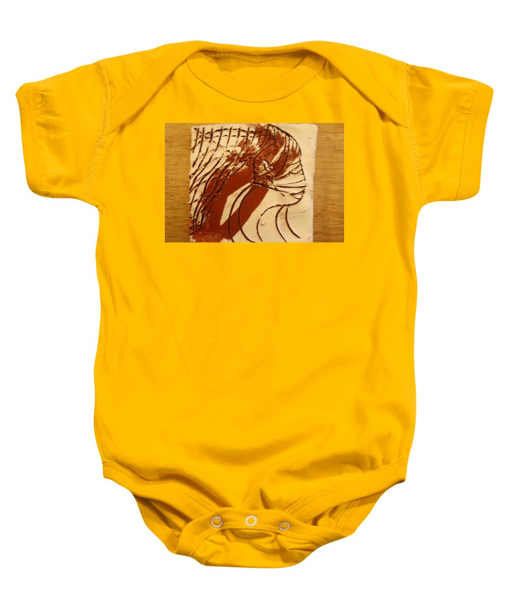 Jesus Baby Onesie featuring the ceramic art East - Tile by Gloria Ssali