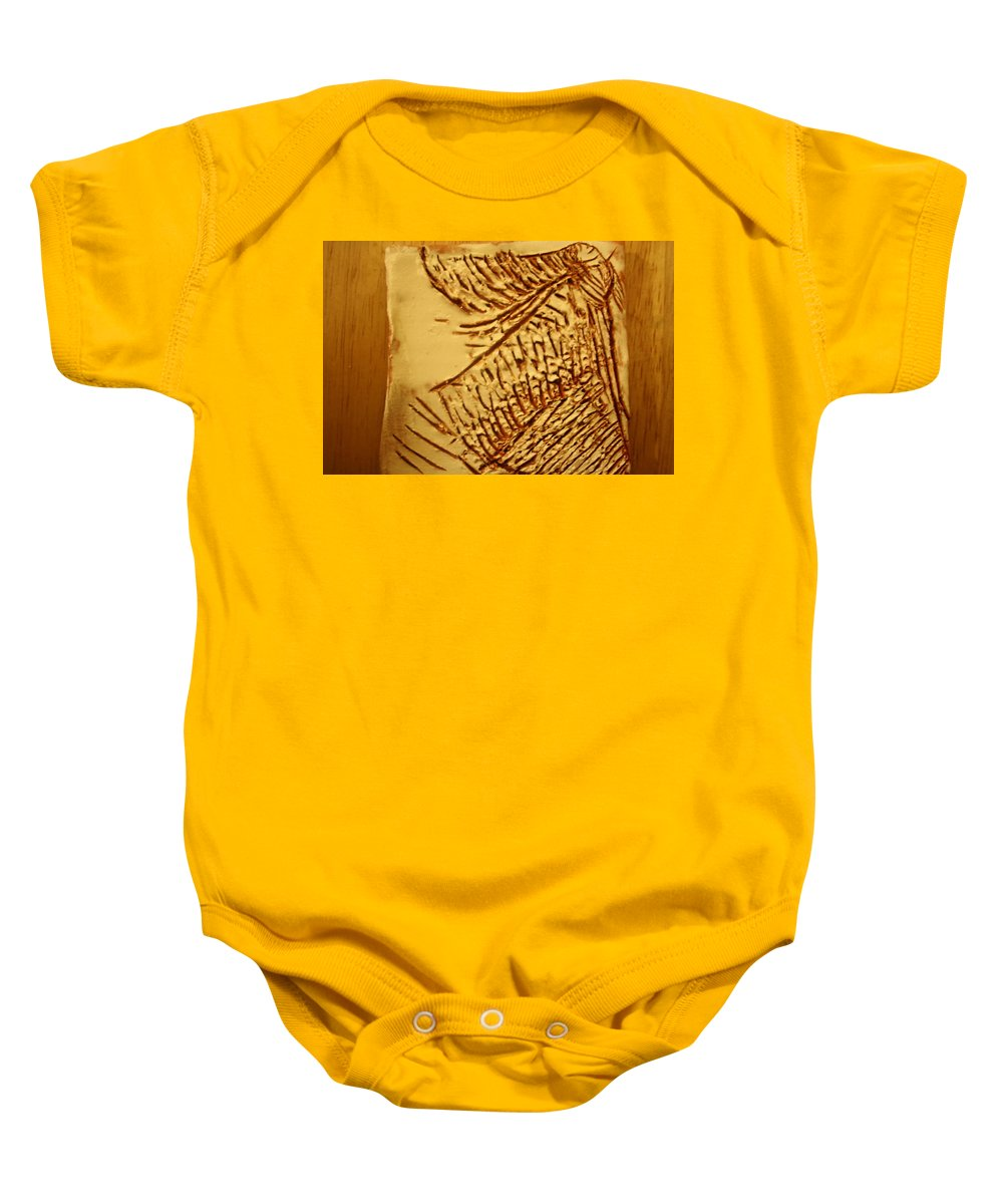 Jesus Baby Onesie featuring the ceramic art Fashion - Tile by Gloria Ssali