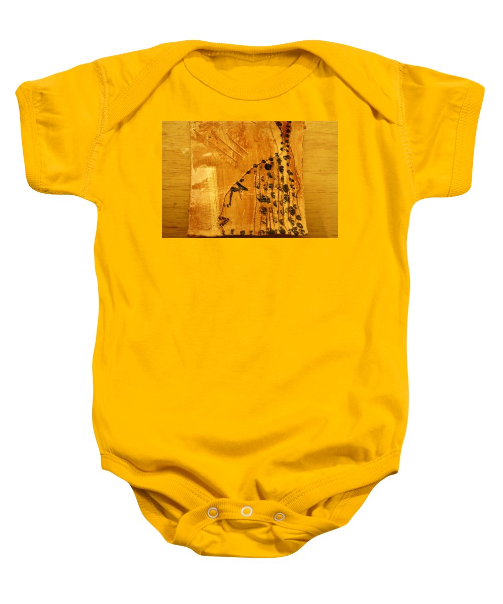 Jesus Baby Onesie featuring the ceramic art Grace Appears - Tile by Gloria Ssali