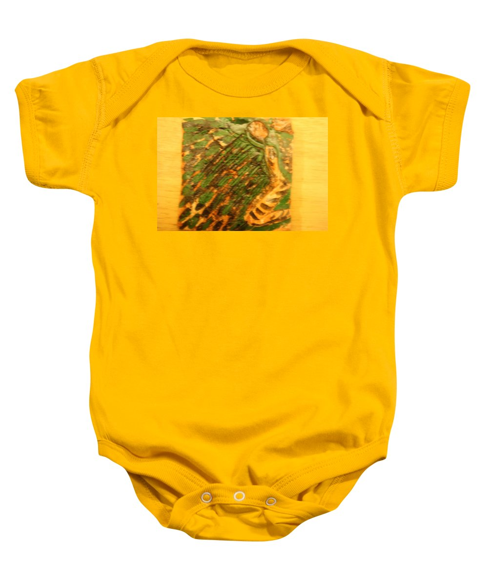 Jesus Baby Onesie featuring the ceramic art Green - Tile by Gloria Ssali