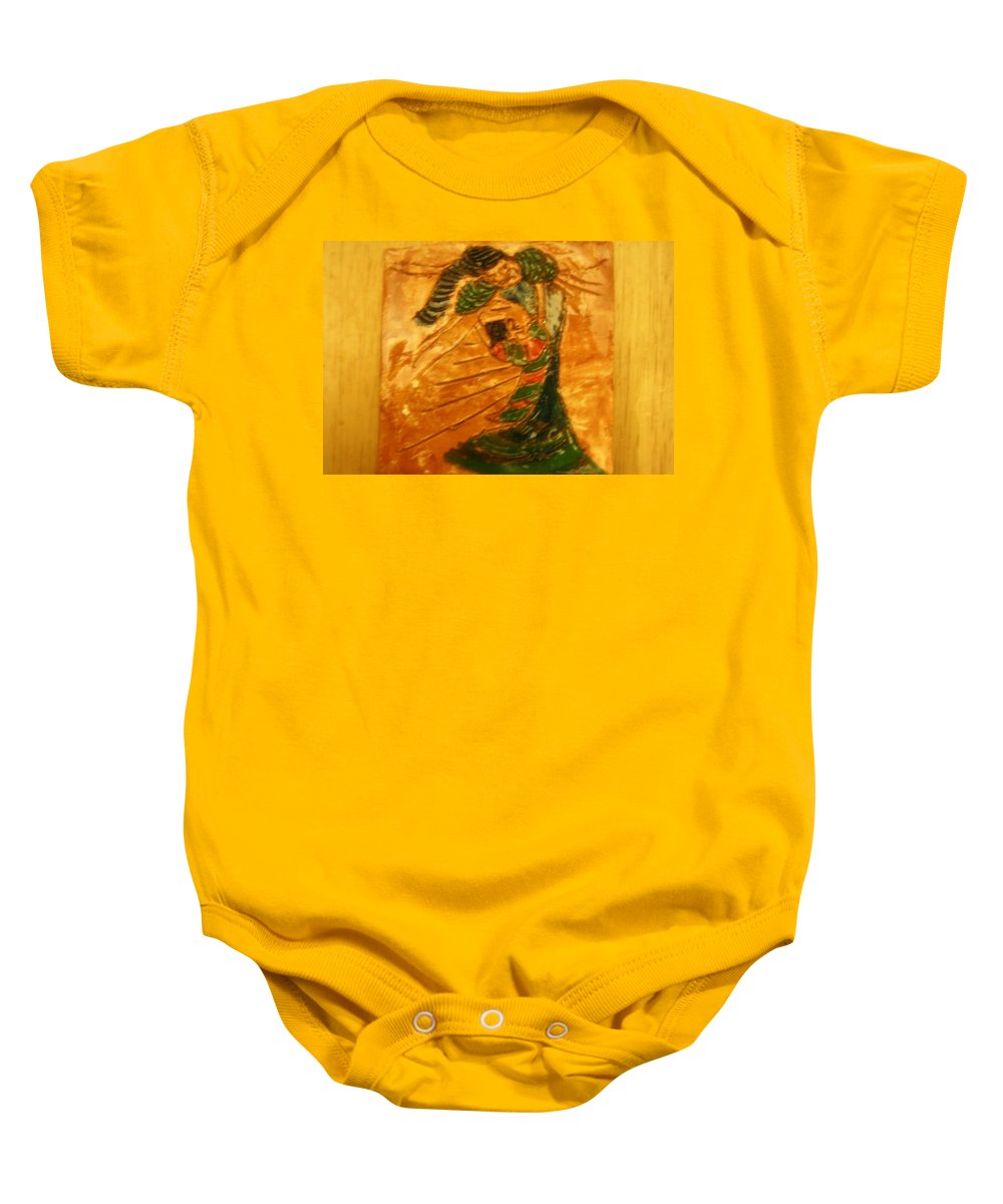 Jesus Baby Onesie featuring the ceramic art Hugs - Tile by Gloria Ssali