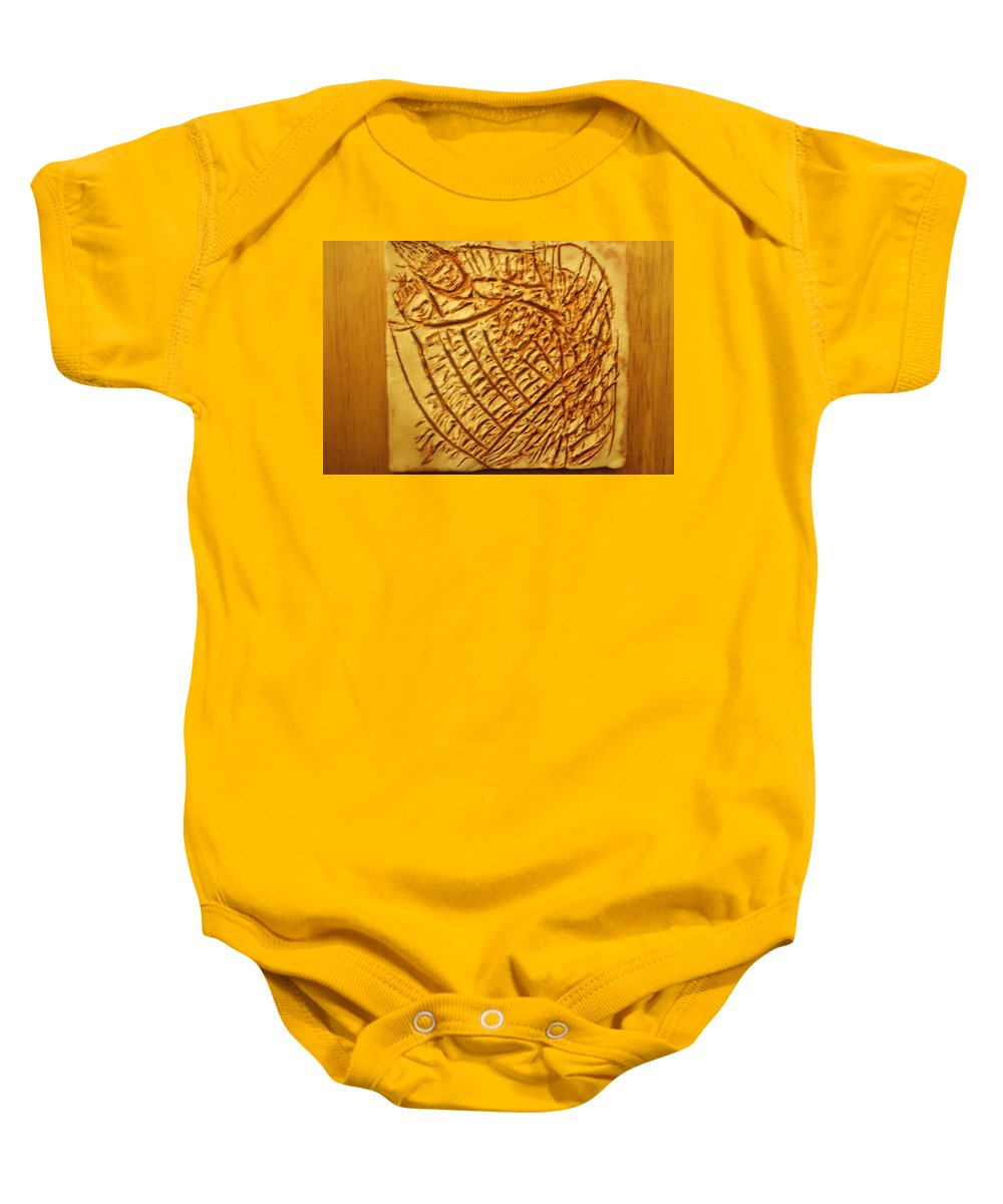 Jesus Baby Onesie featuring the ceramic art Hugtime - Tile by Gloria Ssali
