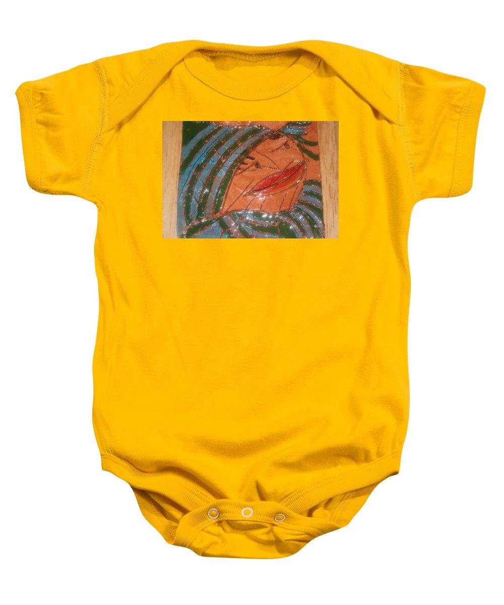 Jesus Baby Onesie featuring the ceramic art Imelda - Tile by Gloria Ssali
