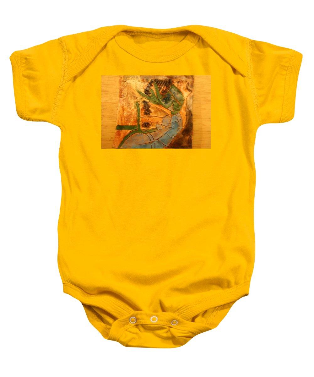 Jesus Baby Onesie featuring the ceramic art Joy Flowing - Tile by Gloria Ssali