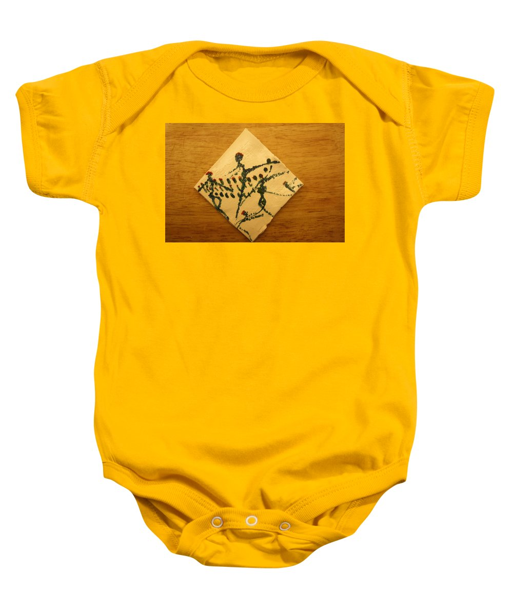 Jesus Baby Onesie featuring the ceramic art Leap - Tile by Gloria Ssali