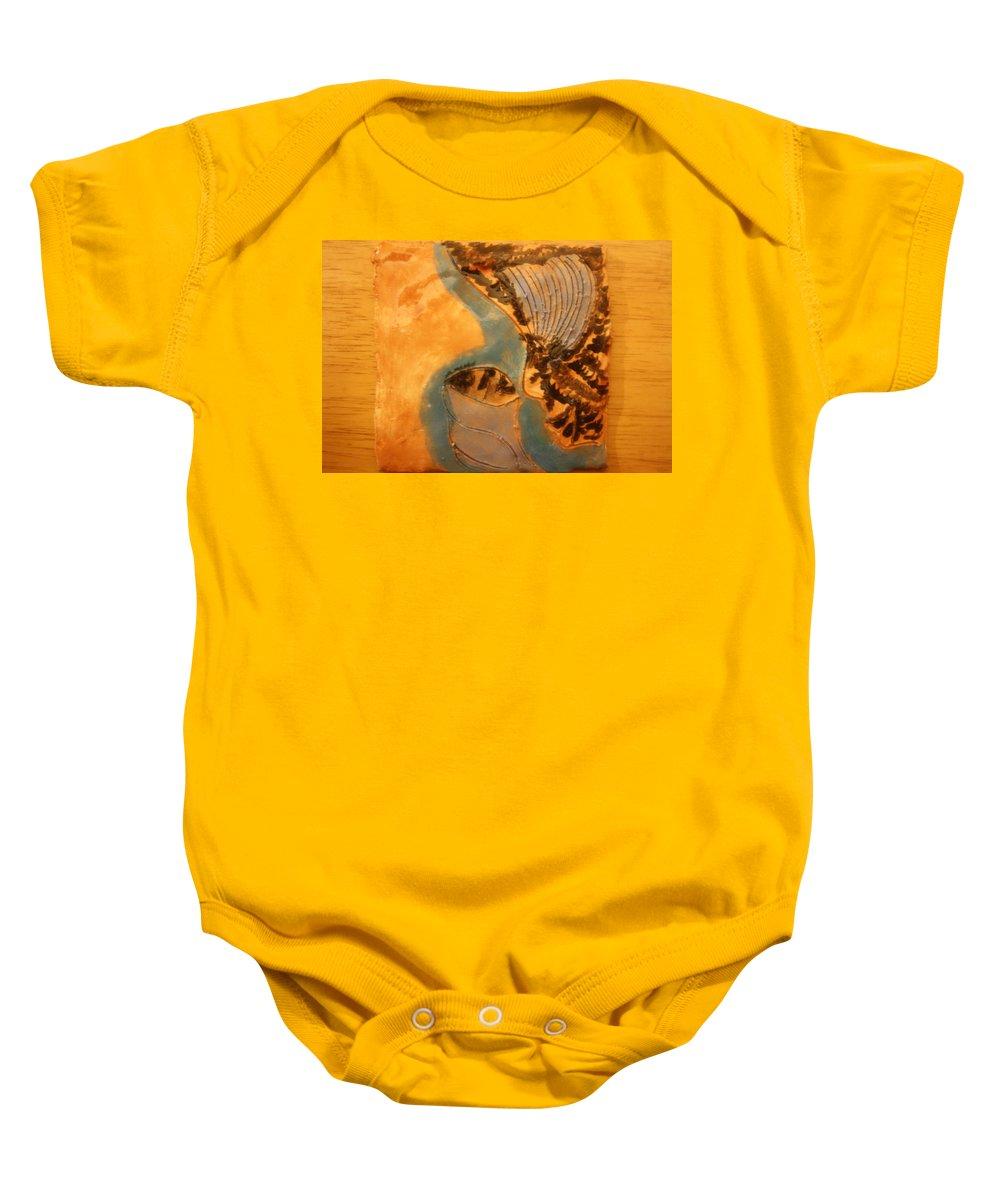 Jesus Baby Onesie featuring the ceramic art Little Angel - Tile by Gloria Ssali