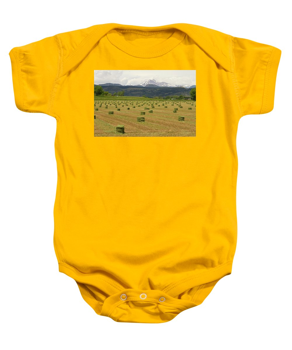 Country Baby Onesie featuring the photograph Mid June Colorado Hay And The Twin Peaks Longs And Meeker by James BO Insogna