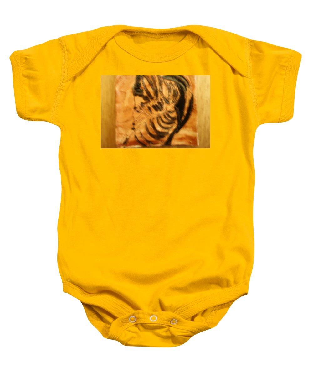 Jesus Baby Onesie featuring the ceramic art Monday - Tile by Gloria Ssali