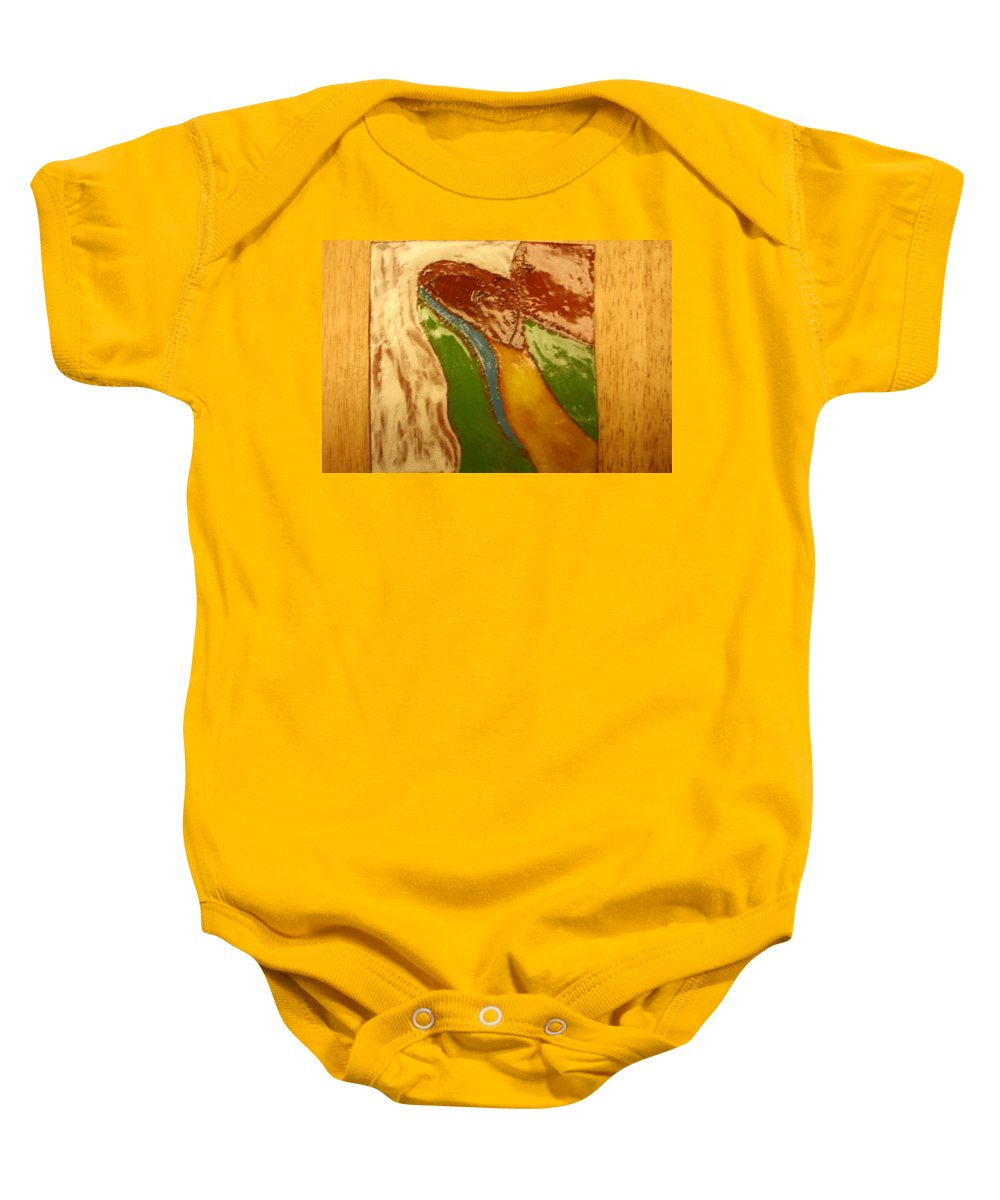 Jesus Baby Onesie featuring the ceramic art Mothers Kiss - Tile by Gloria Ssali