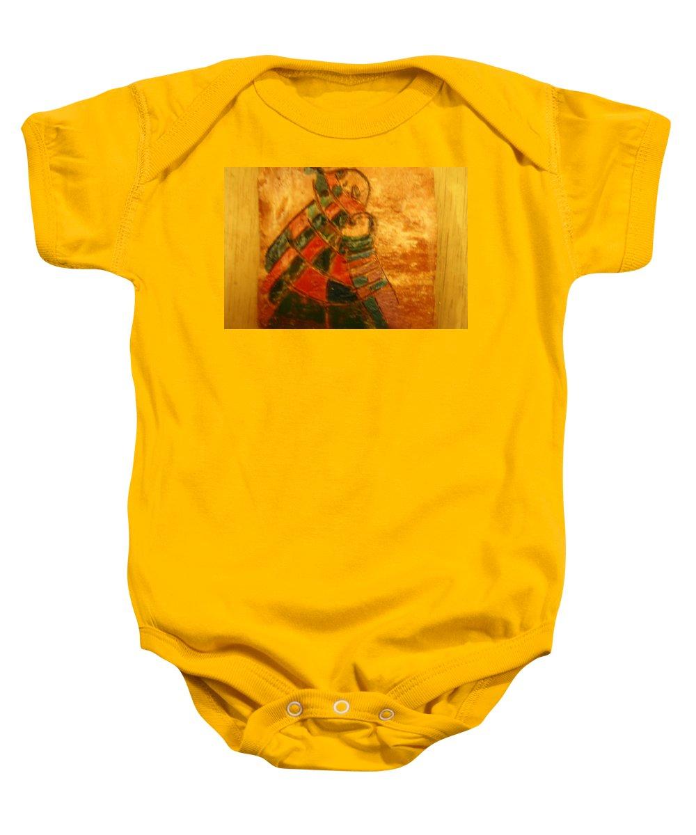 Jesus Baby Onesie featuring the ceramic art Mums Warmth - Tile by Gloria Ssali