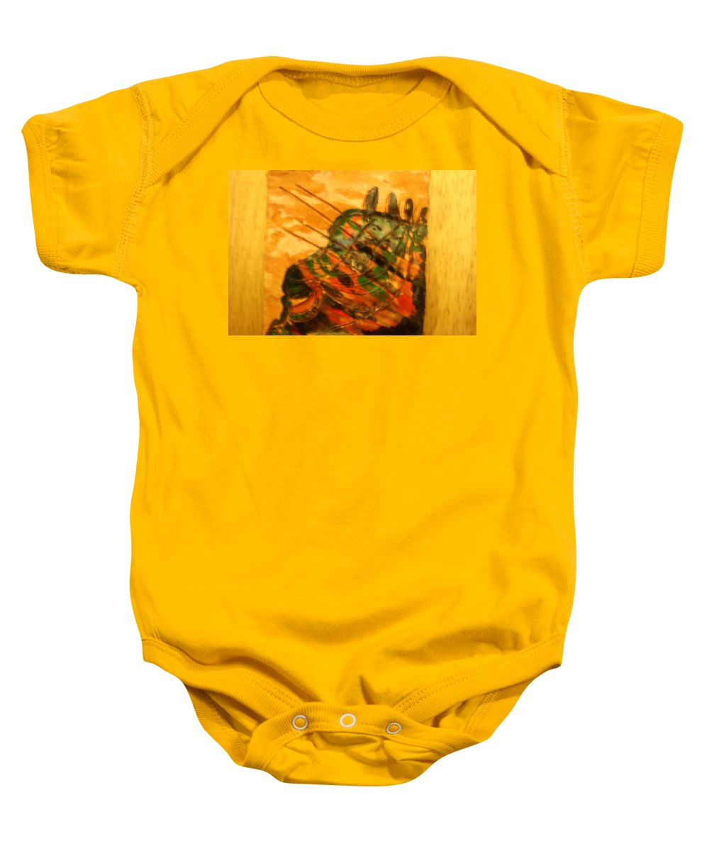 Jesus Baby Onesie featuring the ceramic art Myriad - Tile by Gloria Ssali