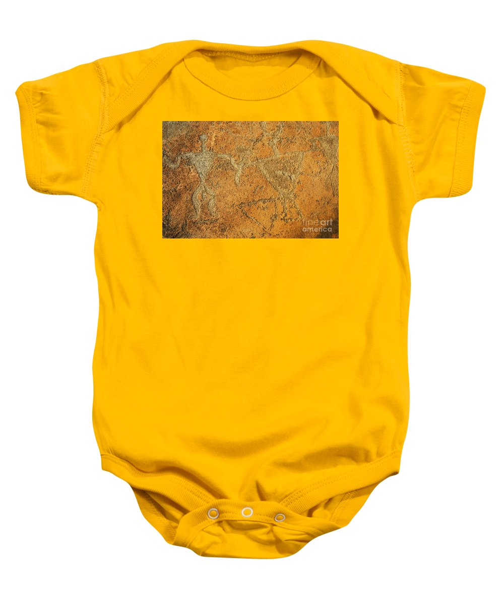 Ancient Baby Onesie featuring the photograph Olowalu Petroglyphs by MakenaStockMedia - Printscapes