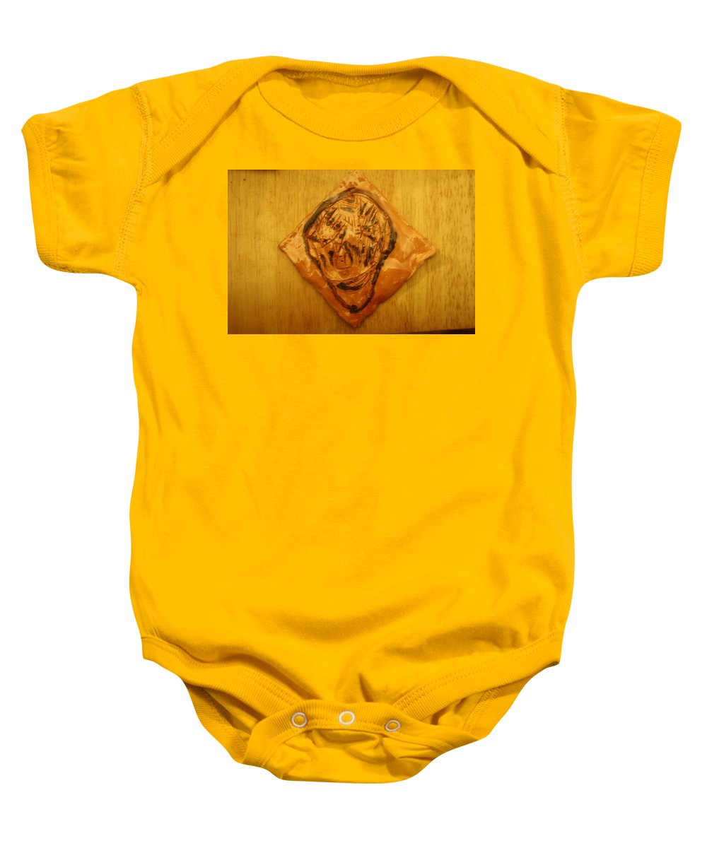 Jesus Baby Onesie featuring the ceramic art Patrick - Tile by Gloria Ssali