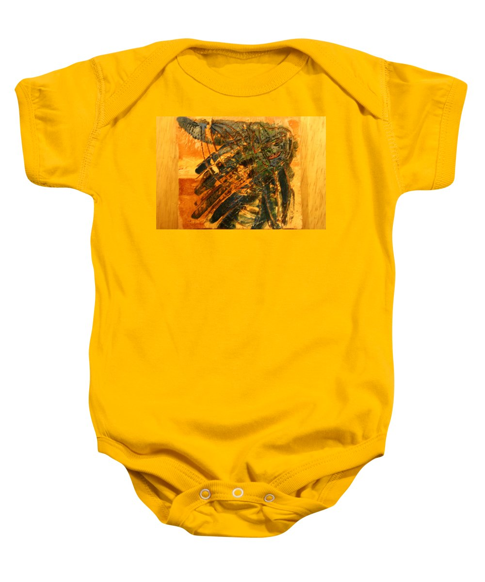 Jesus Baby Onesie featuring the ceramic art Plastered - Tile by Gloria Ssali