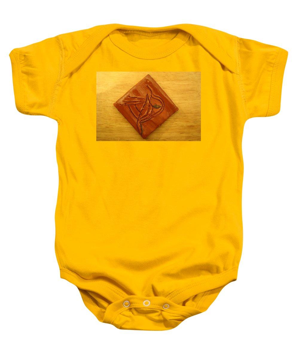Jesus Baby Onesie featuring the ceramic art Reminder - Tile by Gloria Ssali