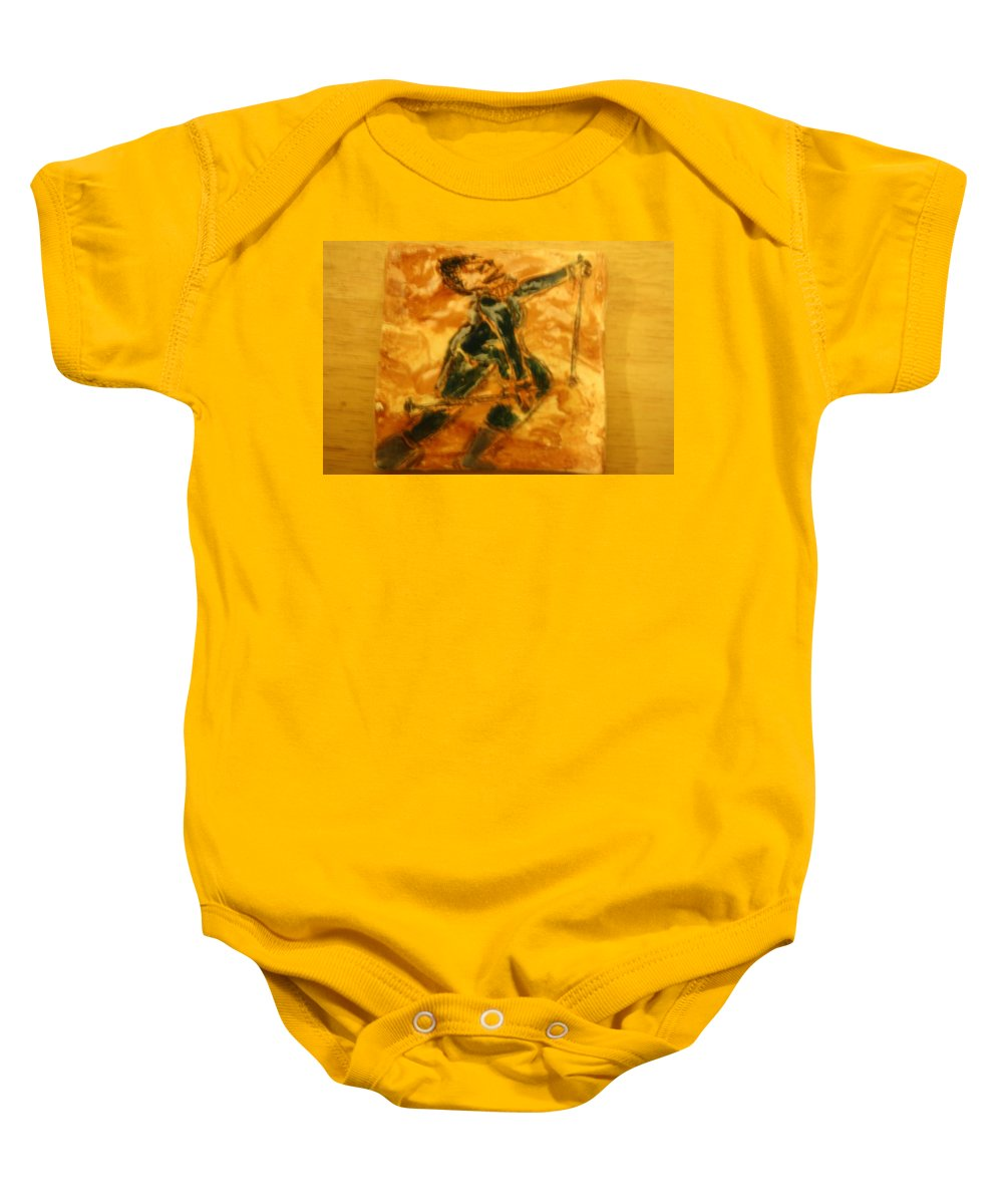 Jesus Baby Onesie featuring the ceramic art Ski Lady - Tile by Gloria Ssali