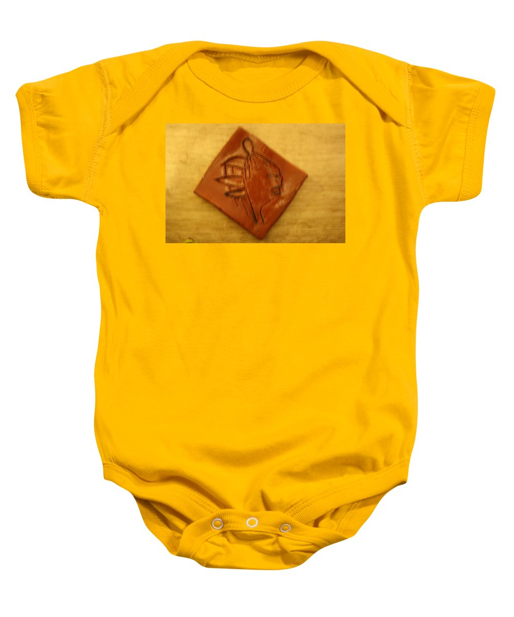 Jesus Baby Onesie featuring the ceramic art Smiles - Tile by Gloria Ssali