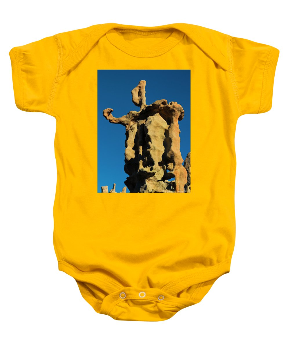 Siltstone Baby Onesie featuring the photograph Stone Bot by Mike Dawson