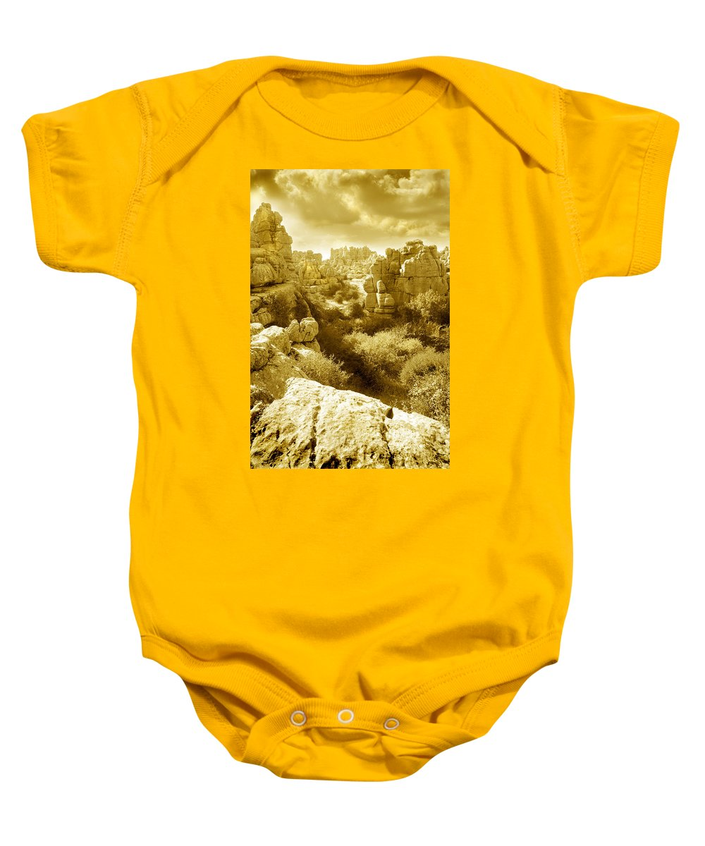 Rock Baby Onesie featuring the photograph Strange Rock Formations At El Torcal Near Antequera Spain by Mal Bray