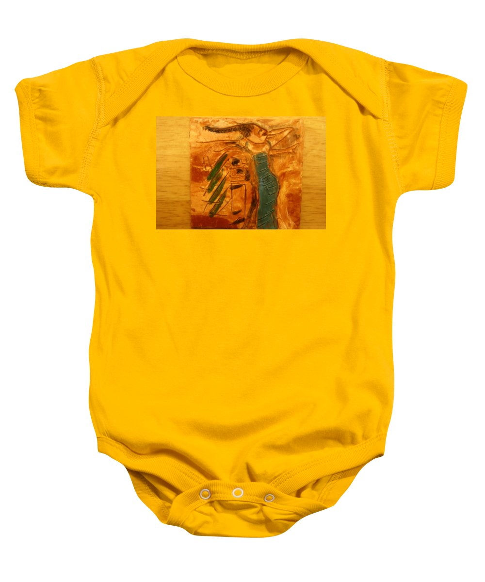Jesus Baby Onesie featuring the ceramic art Stretch - Tile by Gloria Ssali