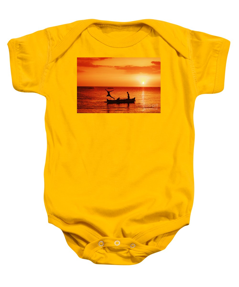 Boat Baby Onesie featuring the photograph Sunset Canoe Jump by Vince Cavataio - Printscapes