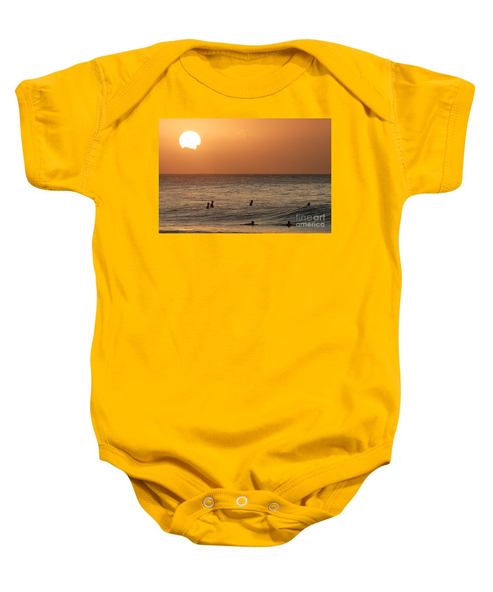 Calm Baby Onesie featuring the photograph Surfers At Sunset by Vince Cavataio - Printscapes
