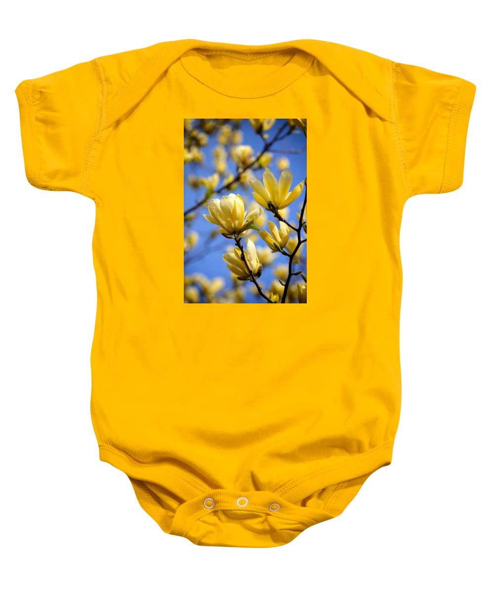 Magnolia Baby Onesie featuring the photograph They Also Come In Yellow by Claudius Cazan