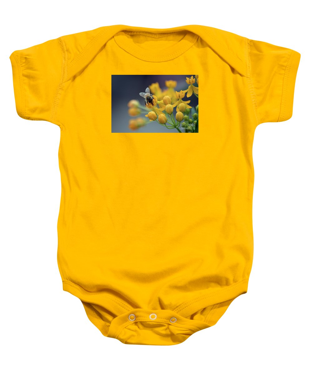 Baby Onesie featuring the photograph Working by Lenin Caraballo